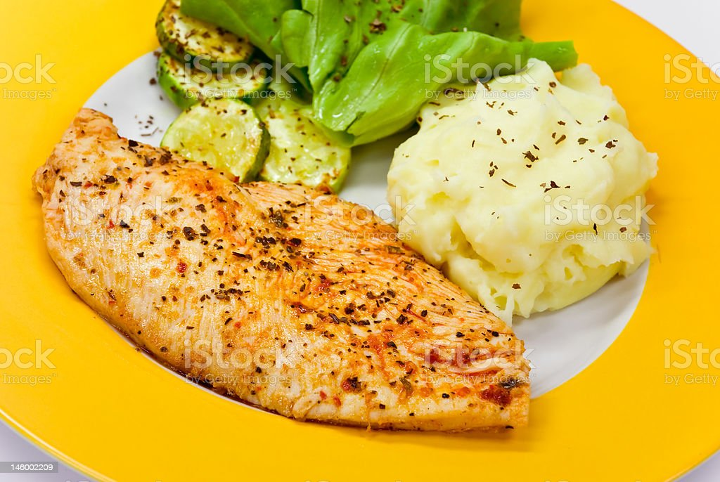 roasted chicken breast with puree,salad royalty-free stock photo