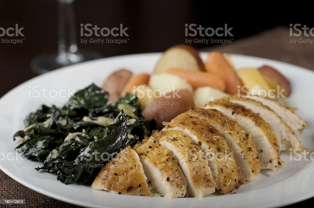 Roasted Chicken Breast with Skin and Vegetables stock photo
