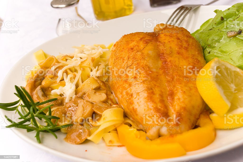 Roasted chicken breast with tagliatelle,cheese,salad royalty-free stock photo