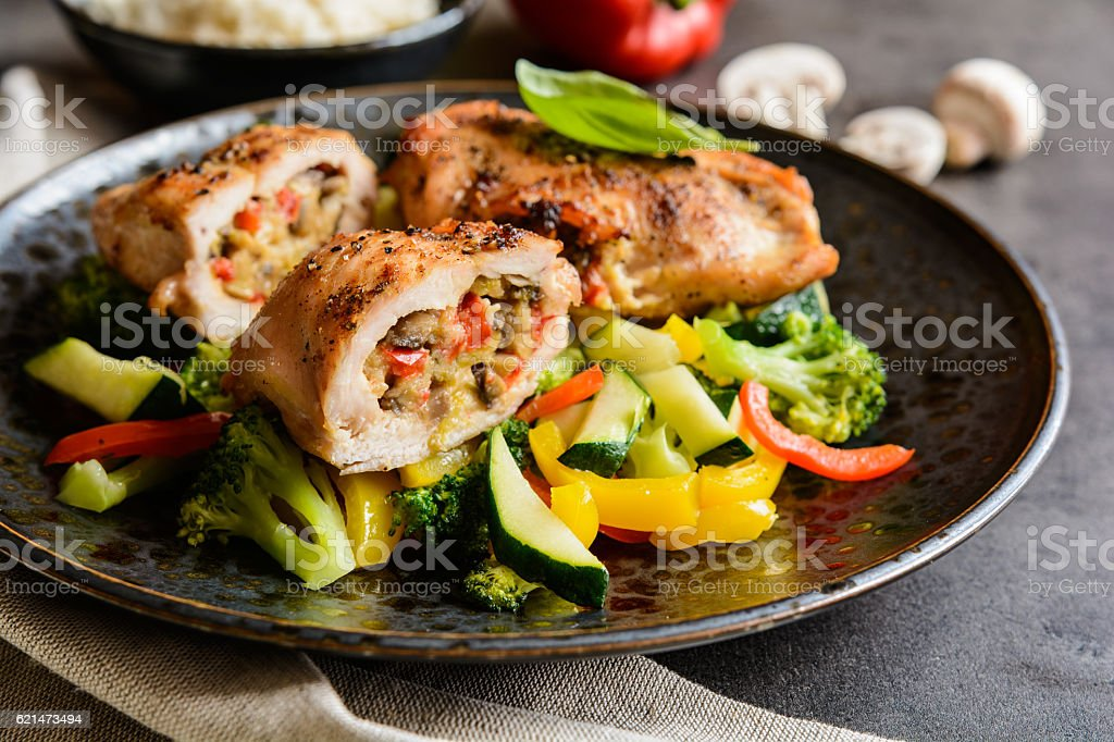Roasted chicken breasts stuffed with vegetable and sheep cheese stock photo