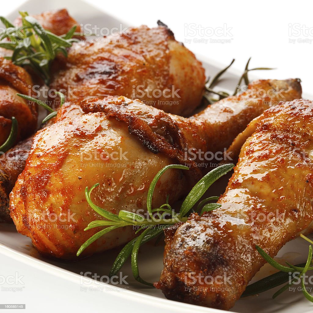 Roasted chicken drumsticks royalty-free stock photo