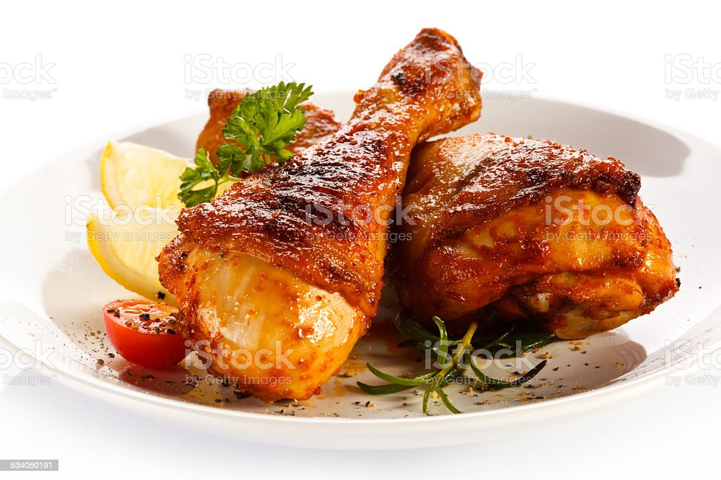 Roasted chicken drumsticks stock photo