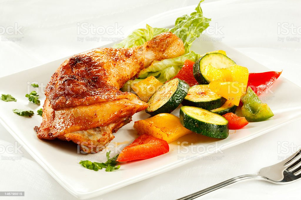Roasted chicken leg and vegetables royalty-free stock photo
