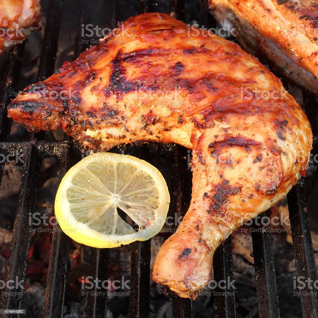 BBQ Roasted Chicken Leg Quarter On The Hot Grill stock photo
