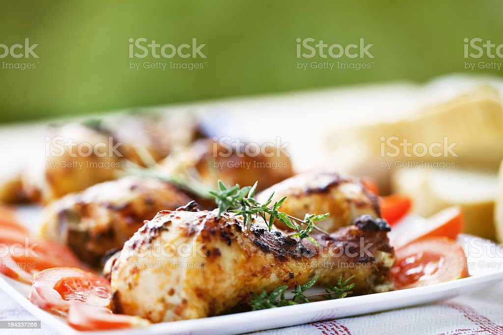 roasted chicken legs at summer picnic stock photo