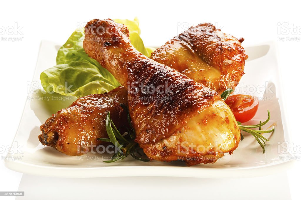 Roasted chicken legs stock photo