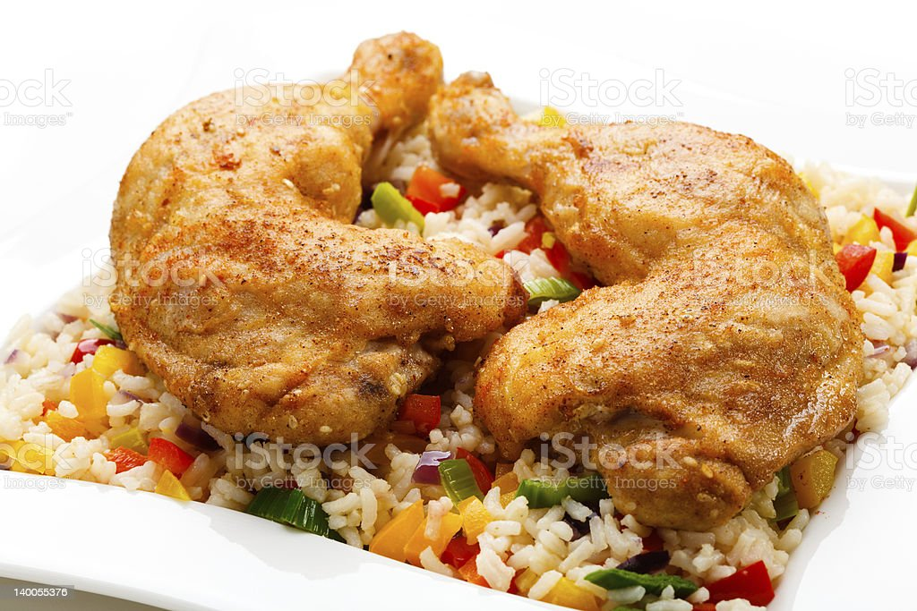 Roasted chicken legs, white rice and vegetables royalty-free stock photo