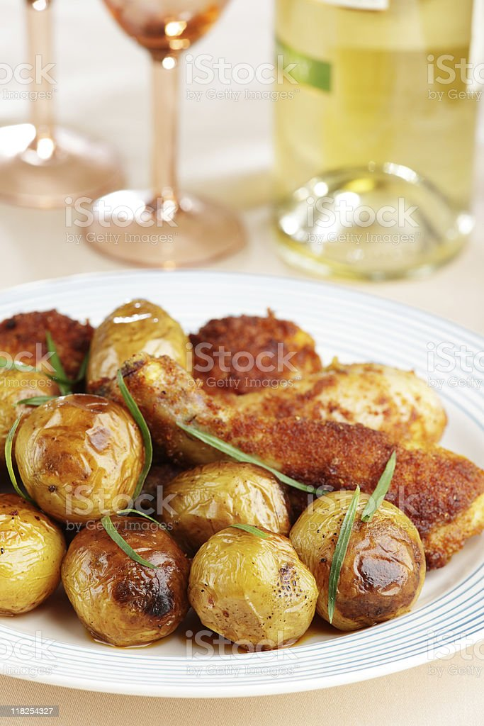 Roasted chicken legs with baked potato royalty-free stock photo