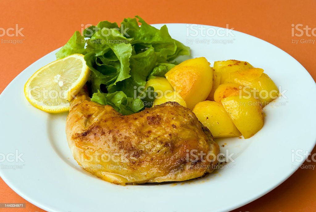 roasted chicken legs with potatoes and salad royalty-free stock photo