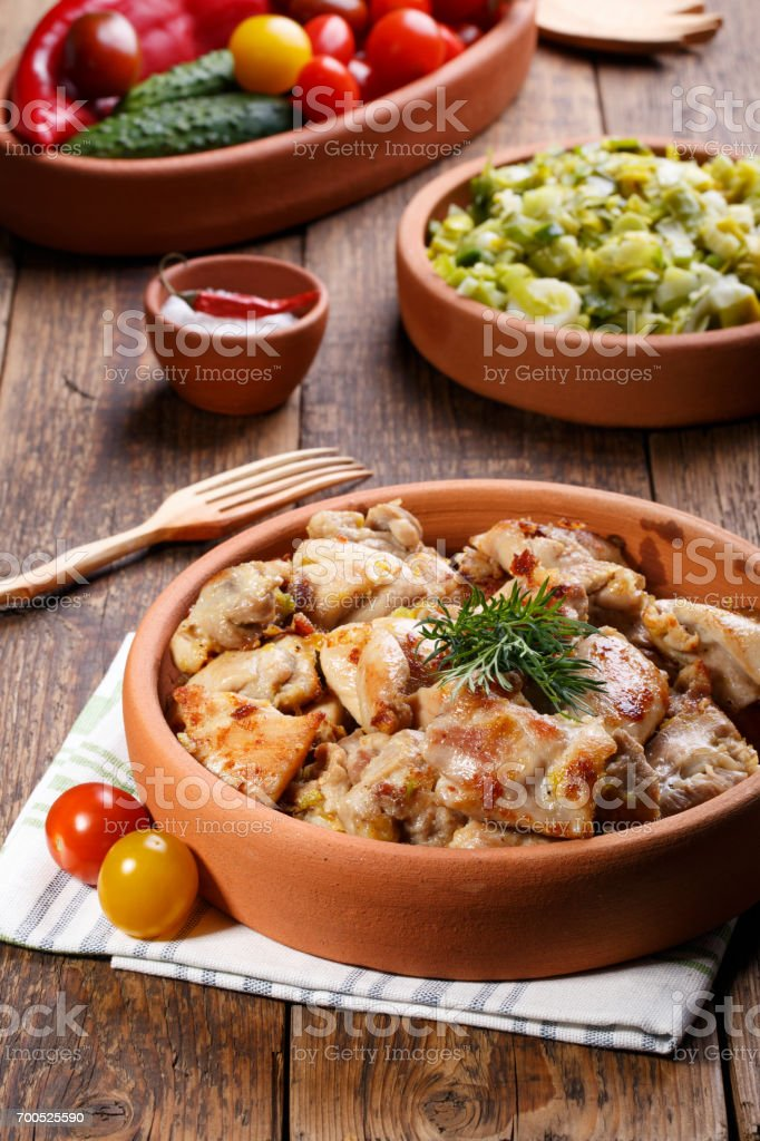 Roasted chicken meat pieces. Grilled boneless skinless chicken thigh. stock photo