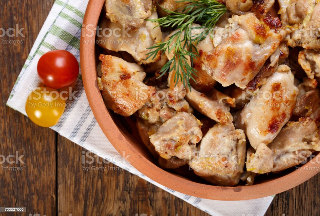 Roasted chicken meat pieces. Grilled boneless skinless chicken thigh. Top view. stock photo