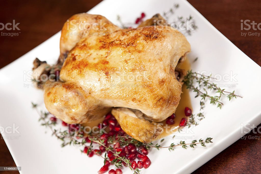Roasted chicken on a platter royalty-free stock photo