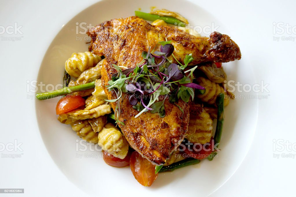 Roasted Chicken over Gnocchi stock photo