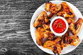 roasted chicken wings with spices,  top view, close-up