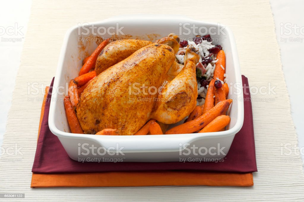 Roasted chicken with carrots and rice stock photo