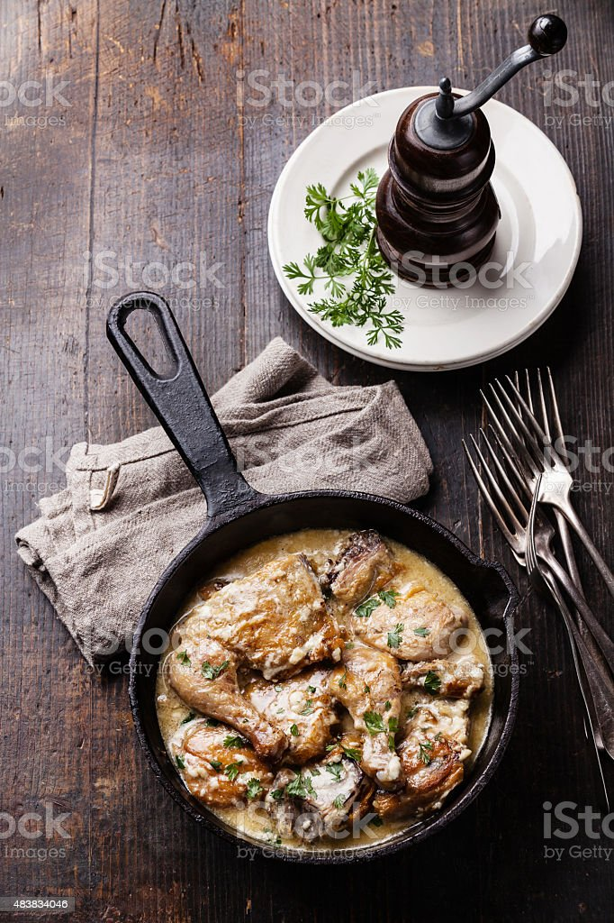 Roasted chicken with creamy garlic sauce stock photo