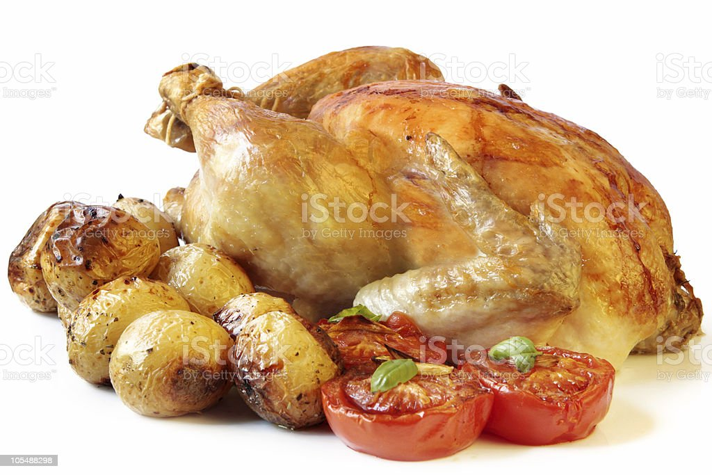 Roasted chicken with potatoes and tomatoes royalty-free stock photo