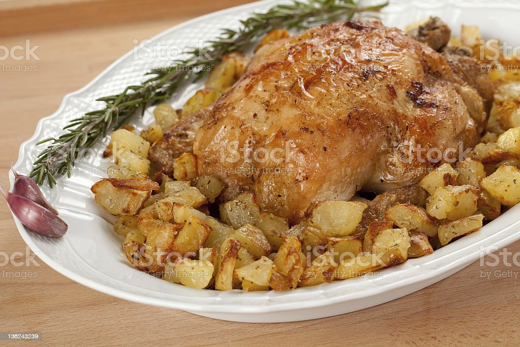 Roasted chicken with potatoes royalty-free stock photo