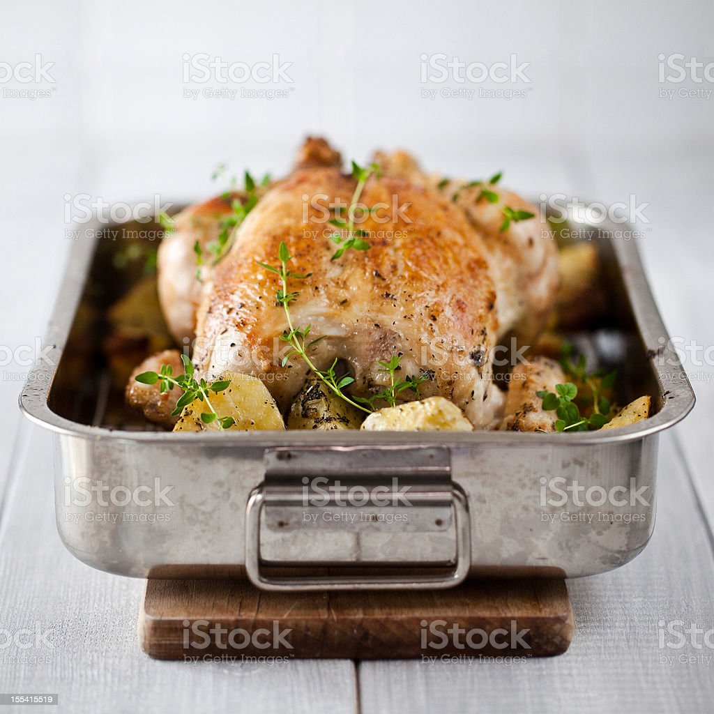 Roasted chicken with potatoes stock photo