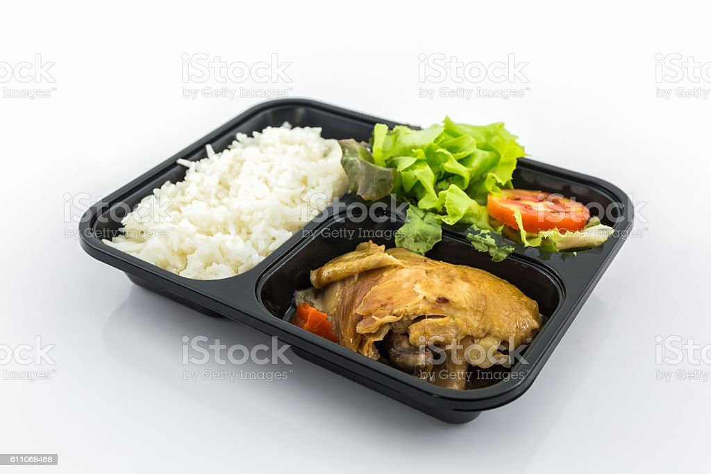Roasted chicken with rice and vegetable salad. stock photo