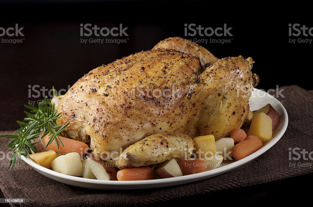 Roasted Chicken with Vegetables on Platter, Black Background stock photo