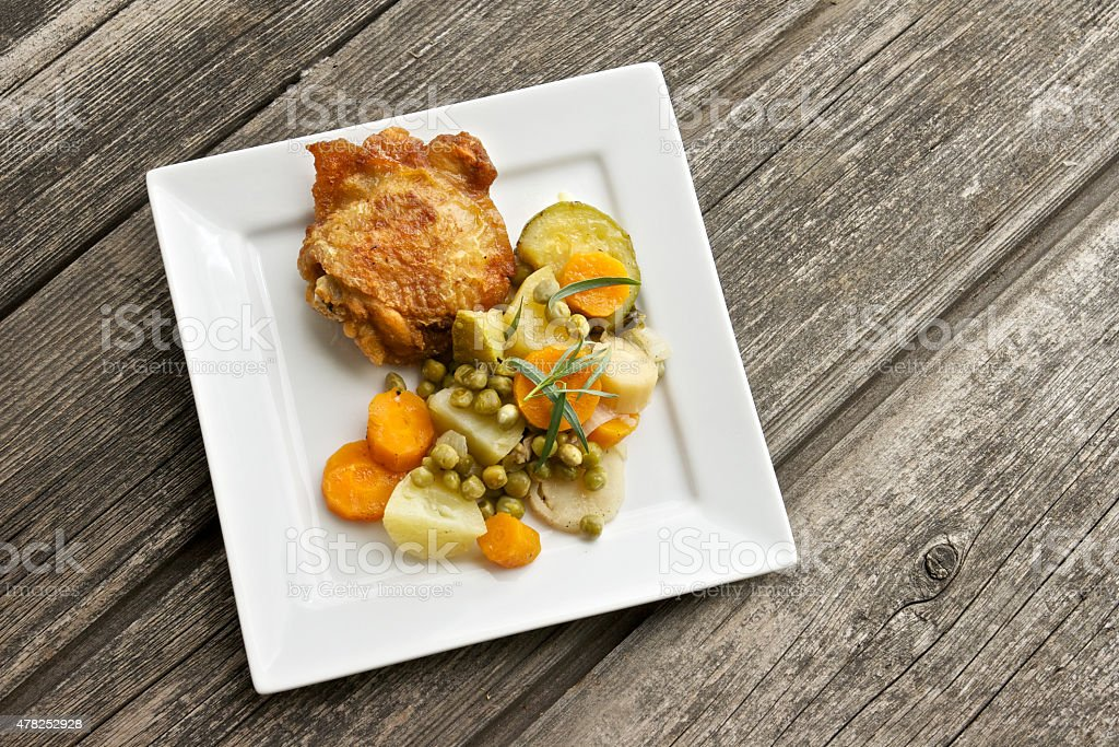 Roasted chicken with vegetables stock photo