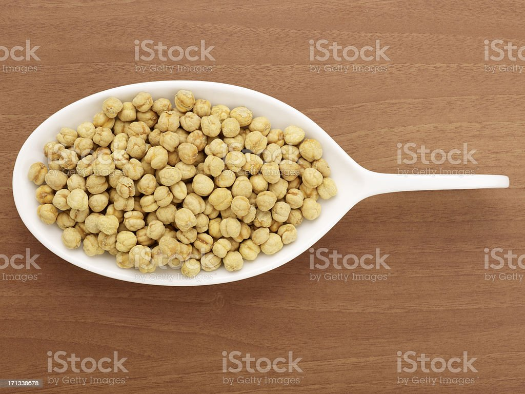 Roasted Chickpeas In A White Plate stock photo