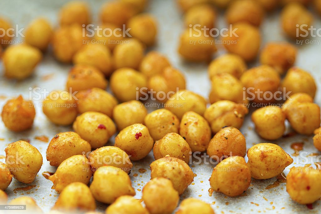 Roasted chickpeas on a baking tray stock photo