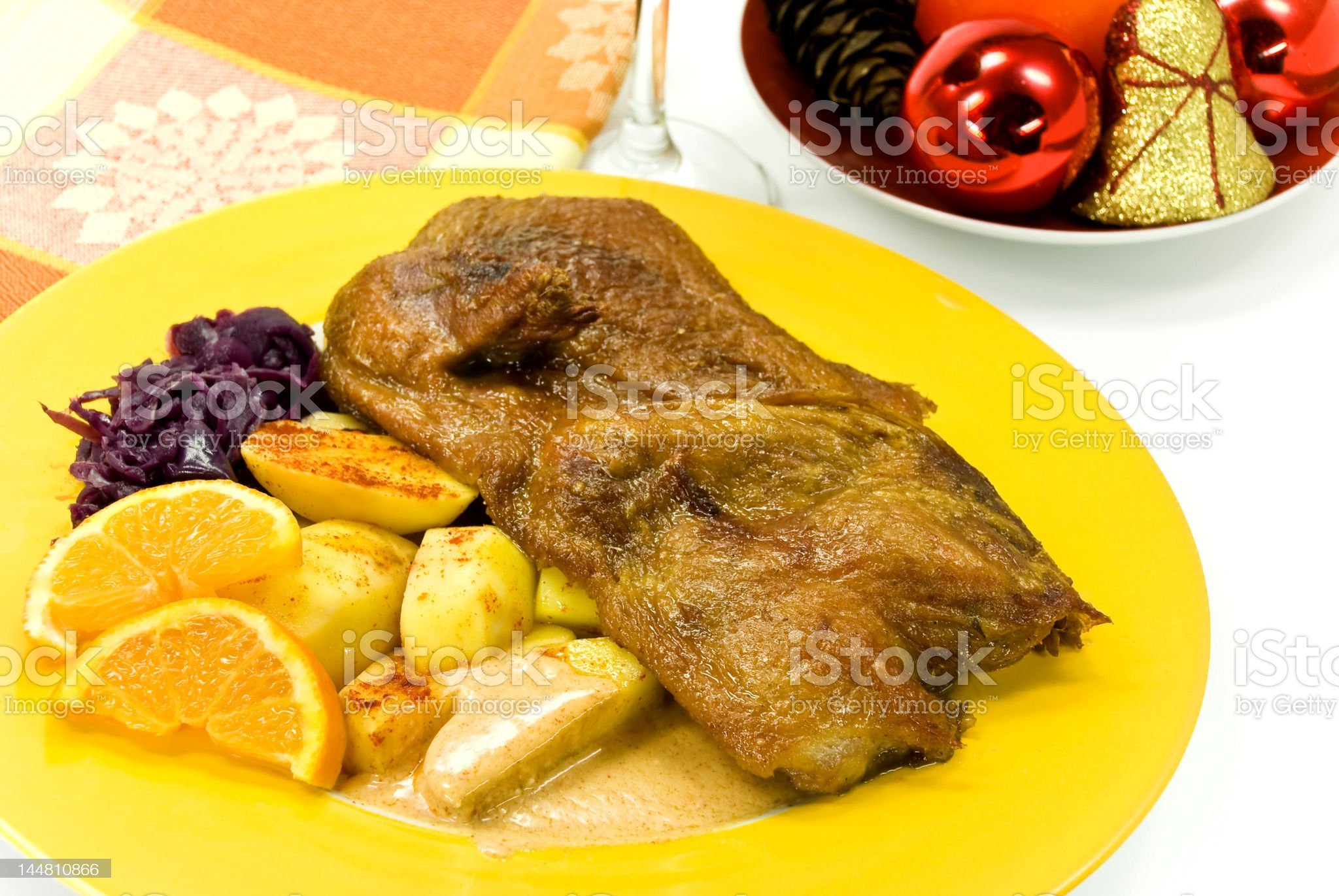 roasted christmas-duck with deep fried potatoes royalty-free stock photo