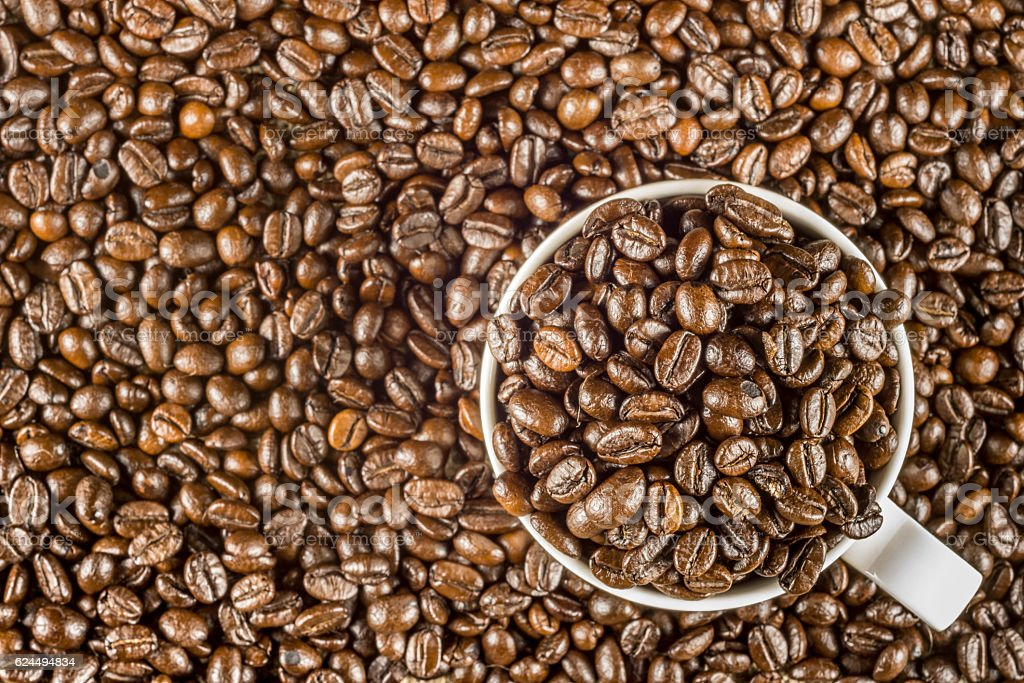 Roasted coffee bean in white cup royalty-free stock photo