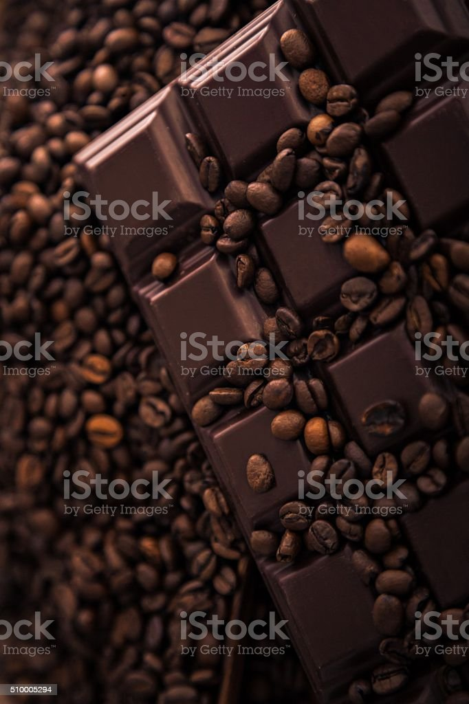 Roasted coffee beans and chocolate bar  close-up stock photo
