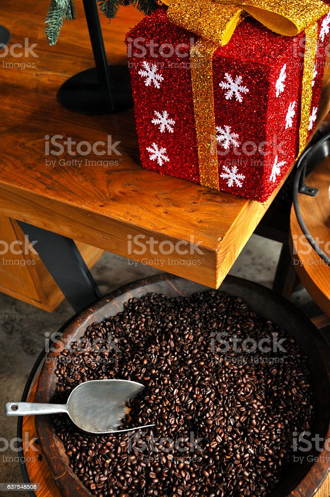Roasted coffee beans and Christmas Ornament stock photo