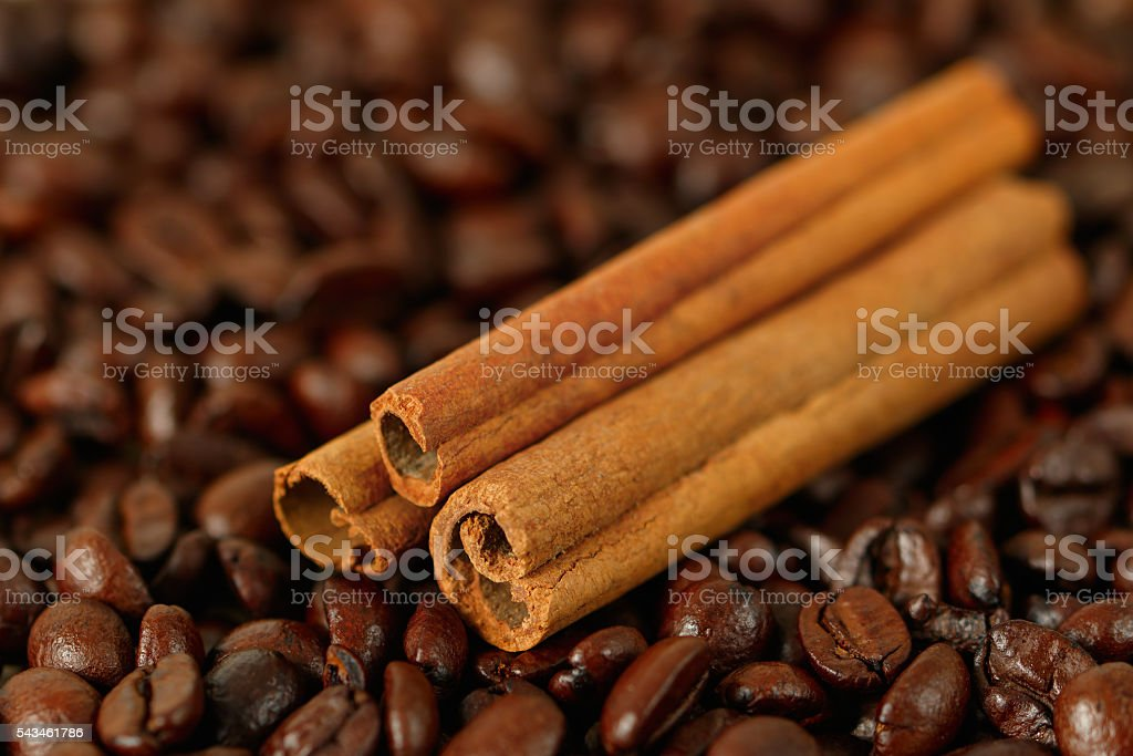 Roasted coffee beans and cinnamon stock photo