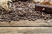 Roasted coffee beans and ground coffee in drawer on table