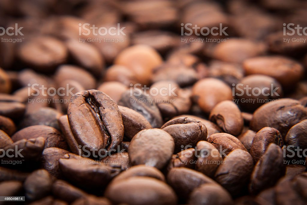 Roasted coffee beans background concept stock photo