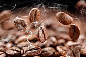 Roasted coffee beans falling