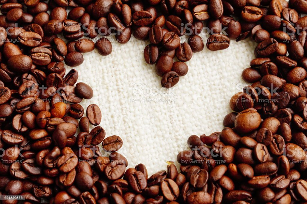 Roasted Coffee beans heart beautiful background stock photo