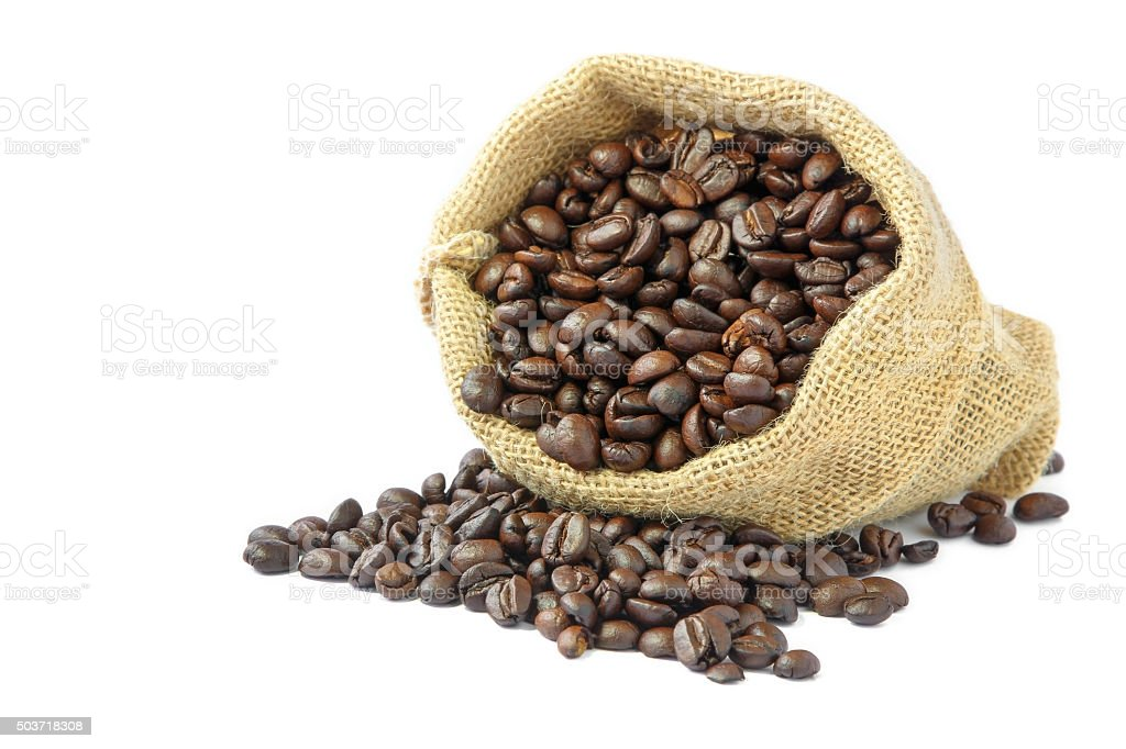 Roasted coffee beans in burlap sack. stock photo