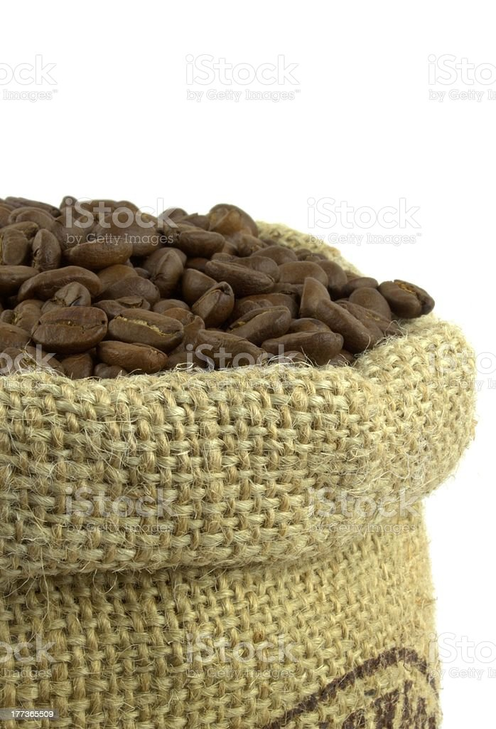 Roasted coffee beans in natural sack royalty-free stock photo
