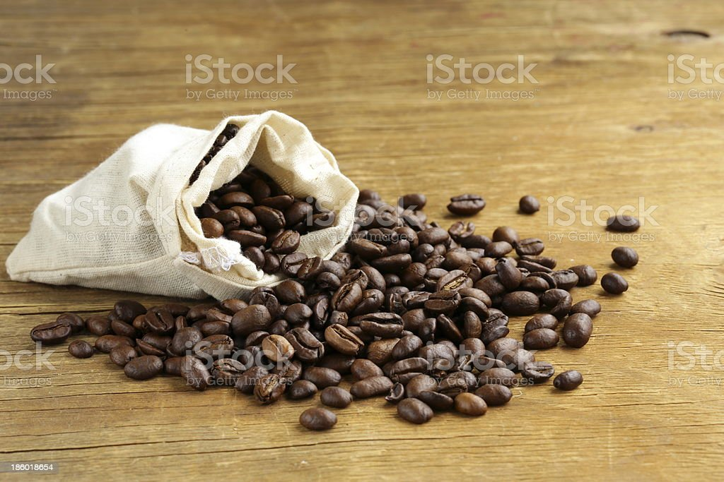 roasted coffee beans on a wooden table royalty-free stock photo