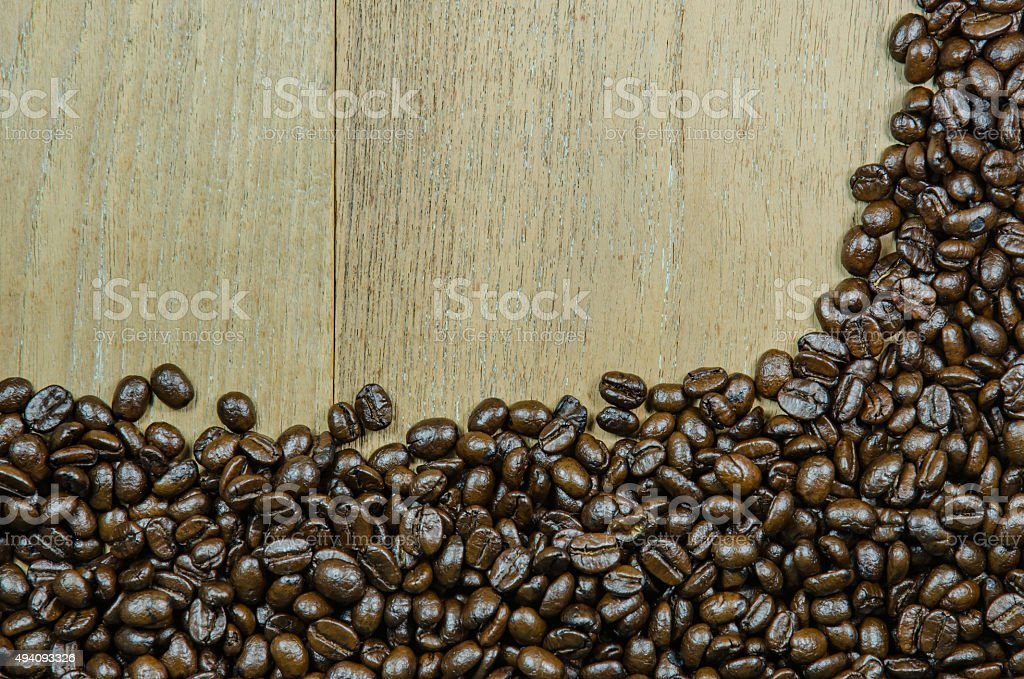 roasted coffee beans on wood background stock photo