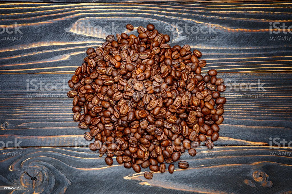 roasted coffee beans on wooden background stock photo