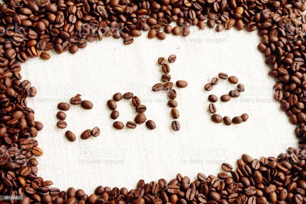 roasted coffee beans with word café in space area , can be used as background stock photo