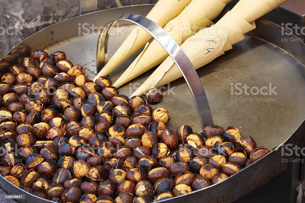 Roasted colorful chestnuts in street cafe royalty-free stock photo