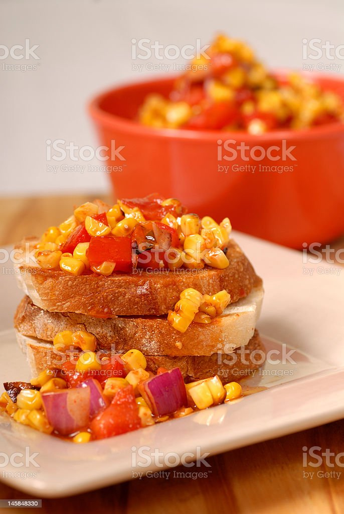 Roasted corn, tomato and onion bruschetta royalty-free stock photo