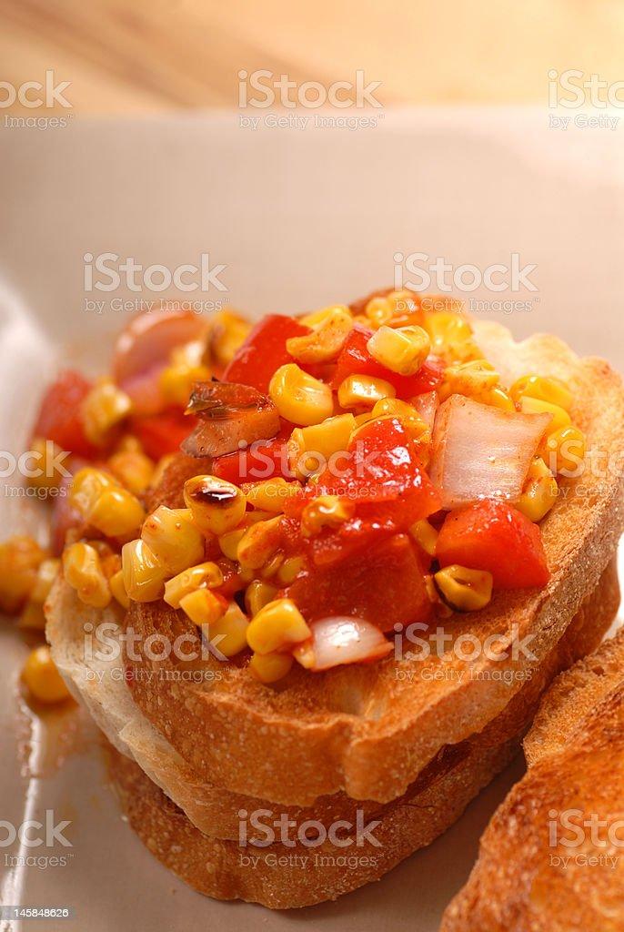 Roasted corn, tomato and onion bruschetta royalty-free stock photo