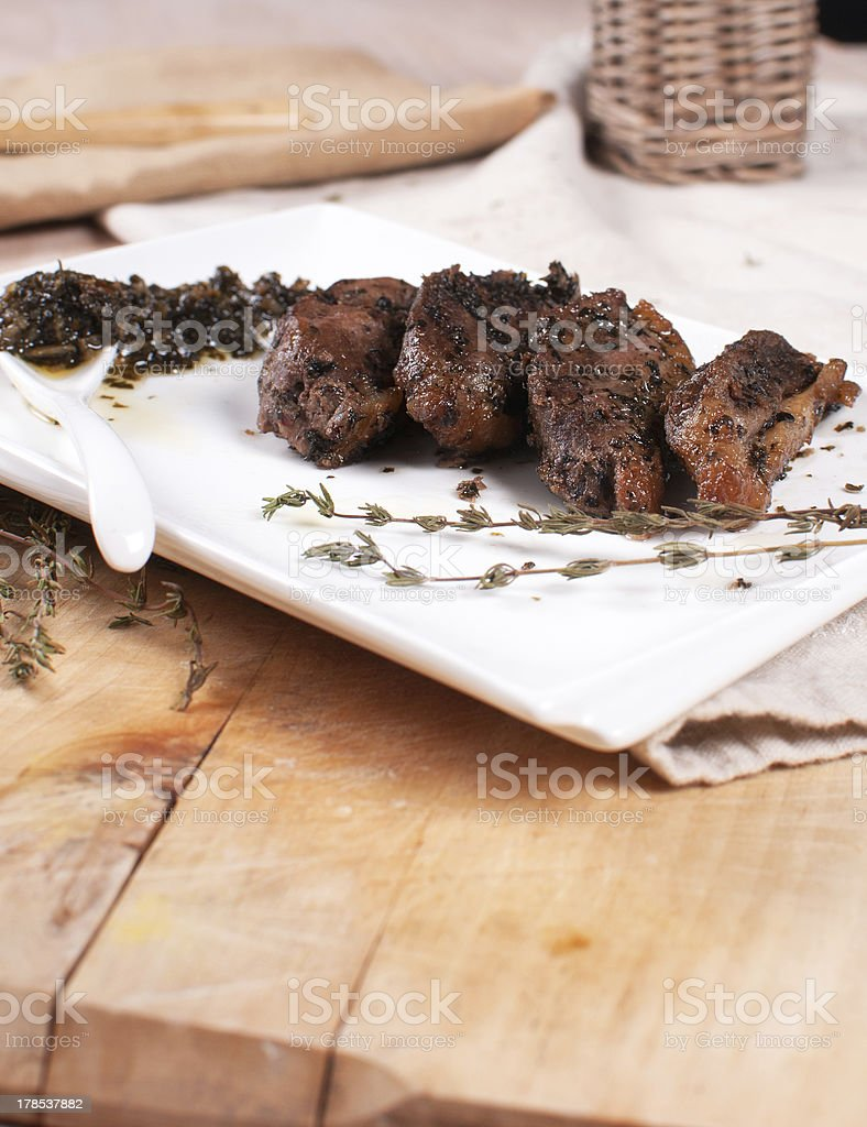 Roasted cut duck with herbs and sauce stock photo