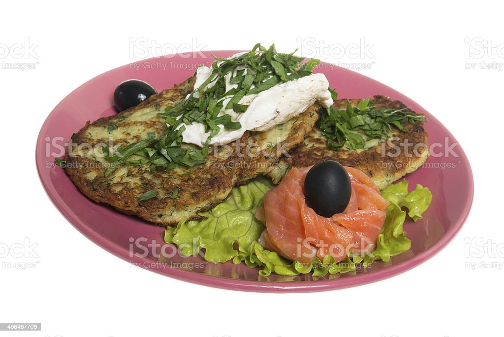 Roasted cutlets of potato with salmon on a plate royalty-free stock photo