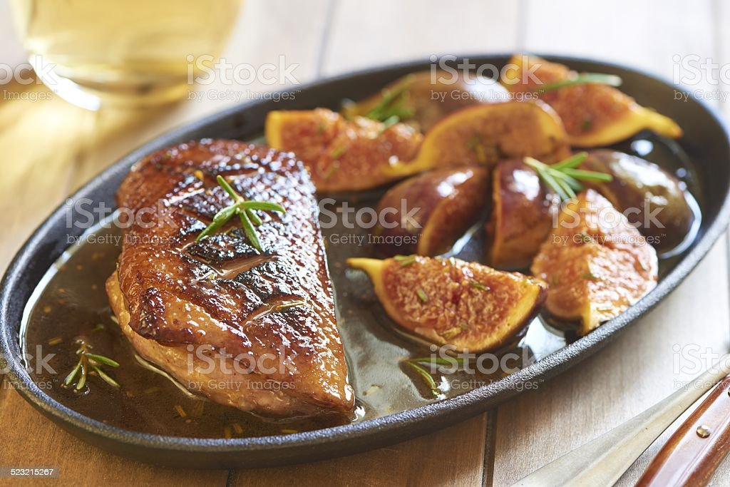 Roasted duck breast with figs and rosemary stock photo