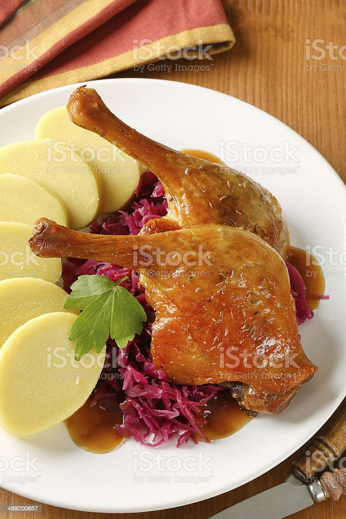 roasted duck, dumplings and cabbage stock photo